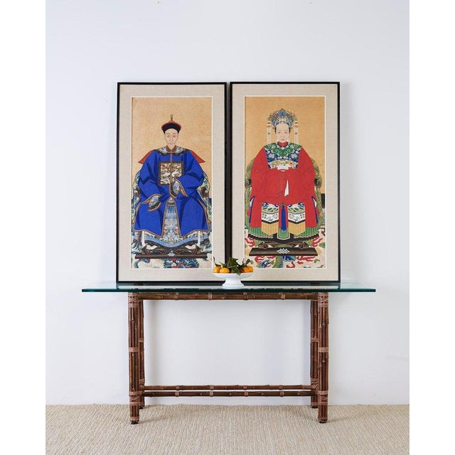 Colorful pair of Chinese ancestor portraits depicting a patriarch and matriarch of high ranking official status. Both...