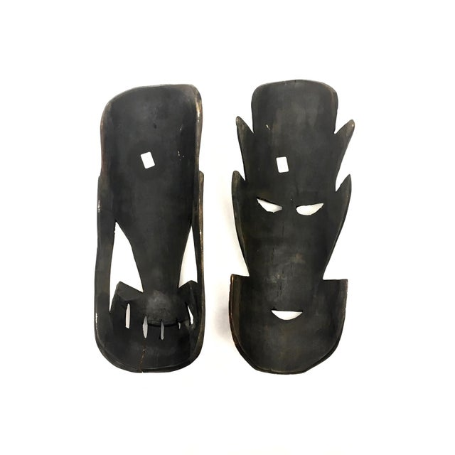 A pair of hand carved tribal wall masks from Kenya. No hanging hardware.