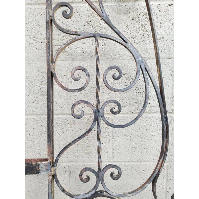 A pair of vintage wrought iron architectural pieces. Nice workmanship in this opposing pair of panels. Measurements do not...