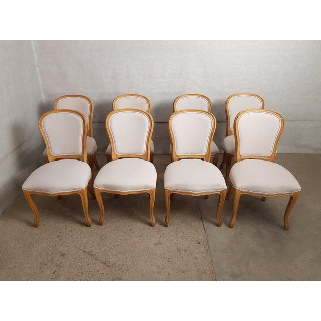 A very elegant fully restored early 20th-century vintage set of 8 Louis XV oak dining chairs newly upholstered in amazing...