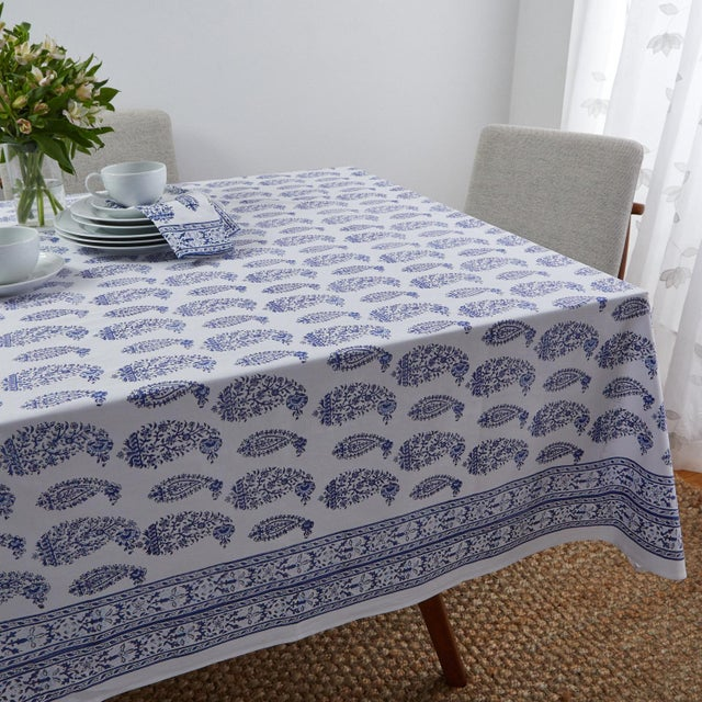 The Malabar Multi-Paisley pattern displays medium and small intricate paisleys with vines and flowers reminiscent of...