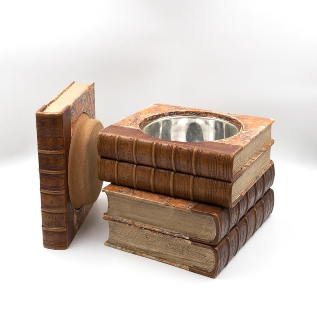 "Five book stack concealed wine cooler; three volumes of ""Magna Britannia"" and two of "" Liber Gelarum"" the top volume..."