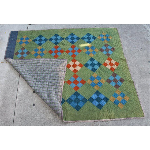 This Lancaster County, Pennsylvania all wool Amish nine patch quilt has minor wear in areas but not a big distraction. The...