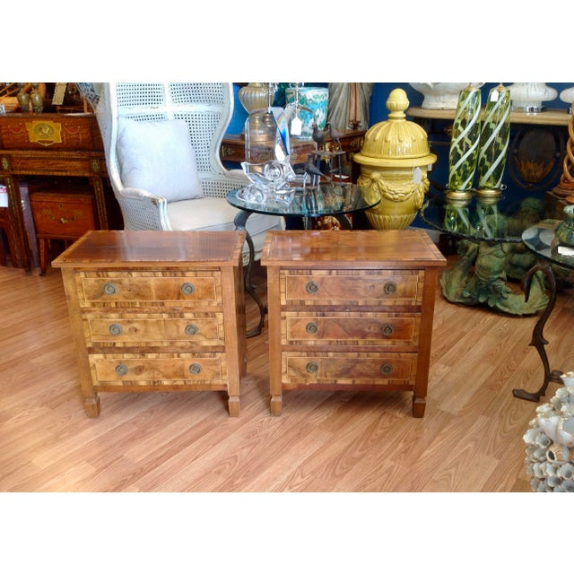 Exquisitely detailed with fine inlays . Nicely stylized chair side chests.