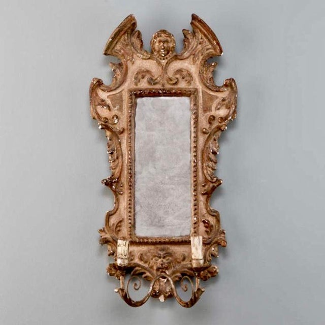 Circa 1890s pair of Italian sconces have mirrored back plates with wood and gesso frames in a painted and gilded finish...