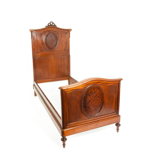 Pair of French hand carved walnut and burl walnut with design detail single bed. Each bed is in excellent antique...