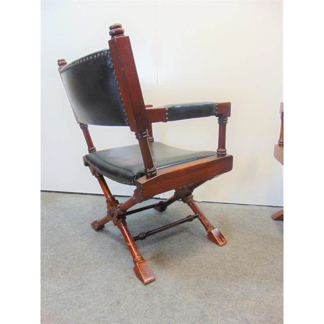 Hollywood Regency Style Directors chairs. Made of Fruitwood with x base design, black leather upholstery with brass...
