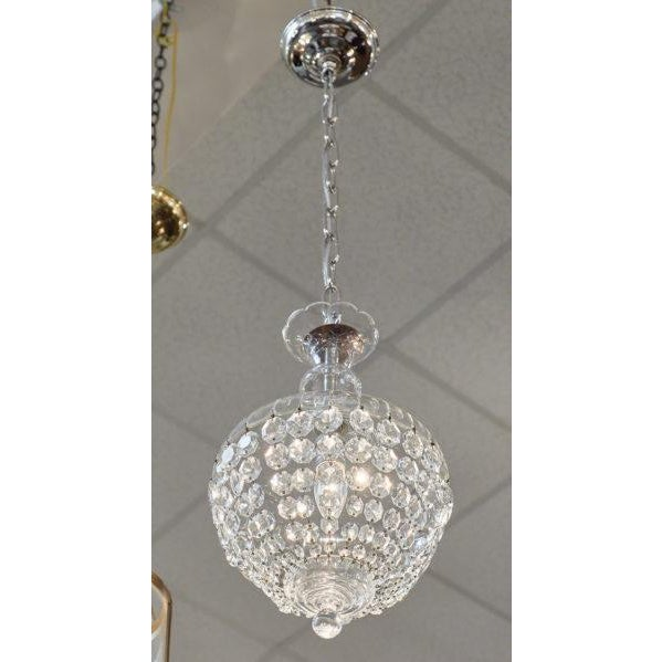 """French antique crystal Baccarat chandelier of multiple strands of cut crystal """"cabochons"""" connected to a crystal bell. We..."""