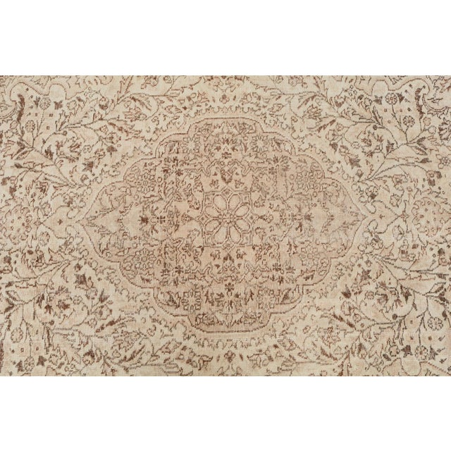 Hand-knotted vintage Turkish rug with a distressed pile and washed out coloring. Perfect for modern or traditional home....