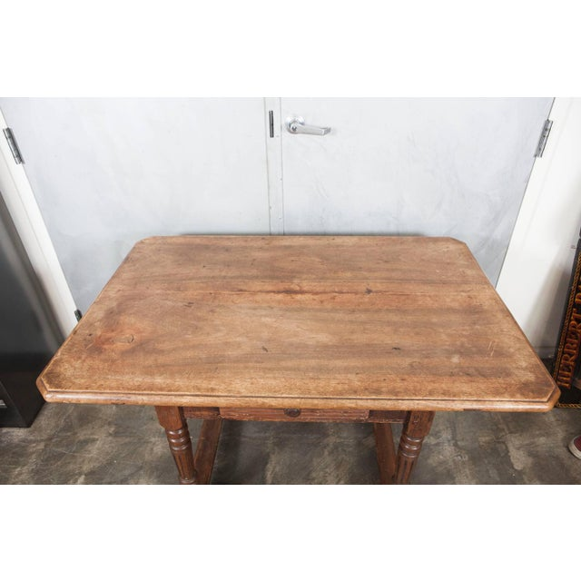 This lovely 18th century table has historical craftsmanship indicative of it's age with peg and dovetail construction and...