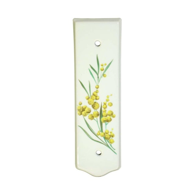 Ceramic white painted push plates with yellow flowers on green vines. Made in France by J.M. Limoges. Priced as a pair....
