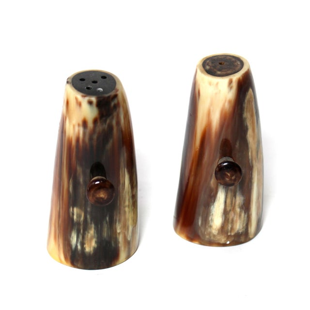 Hand-crafted from natural materials, these shakers are striking and functional.