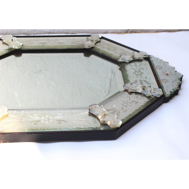 Venetian style etched glass mirror.