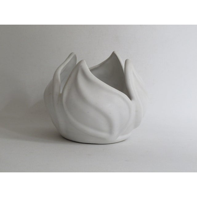 """Ceramic vessel made famous American pottery studio Van Briggle in a swirling leaf motif. Marked on the bottom """"Van..."""