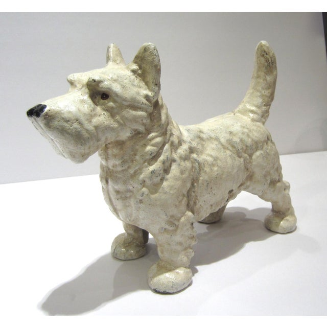 A charming cast iron doorstop of a white West Highland terrier. Excellent condition, with expected paint imperfections....