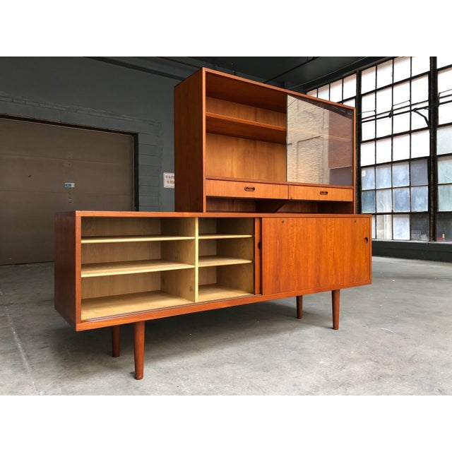 A stunning and hard to find teak credenza with accompanying hutch by Hans Wegner for Ry Møbler. This is Wegner's Model...