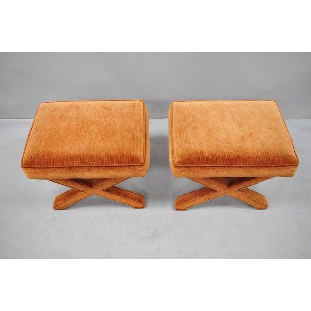 Pair of Vintage Orange X-Base Frame Upholstered Hollywood Regency Stools. Item features fully upholstered X-form frames,...