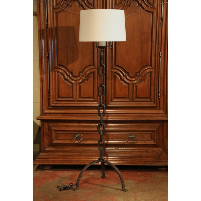This large wrought iron floor lamp was forged in the south of France circa 1880. The tall lamp with new wiring and foot...