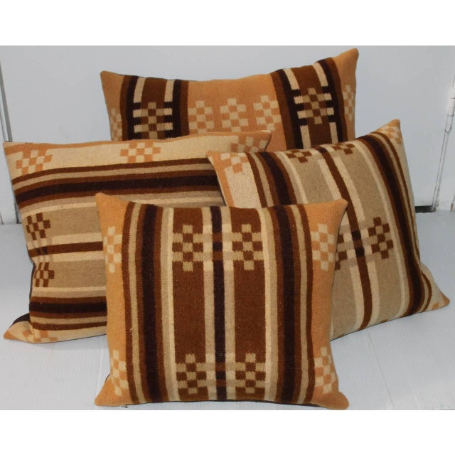 These pillows were made from a 19Thc horse blanket and all have brown cotton linen backings. The inserts are down and...