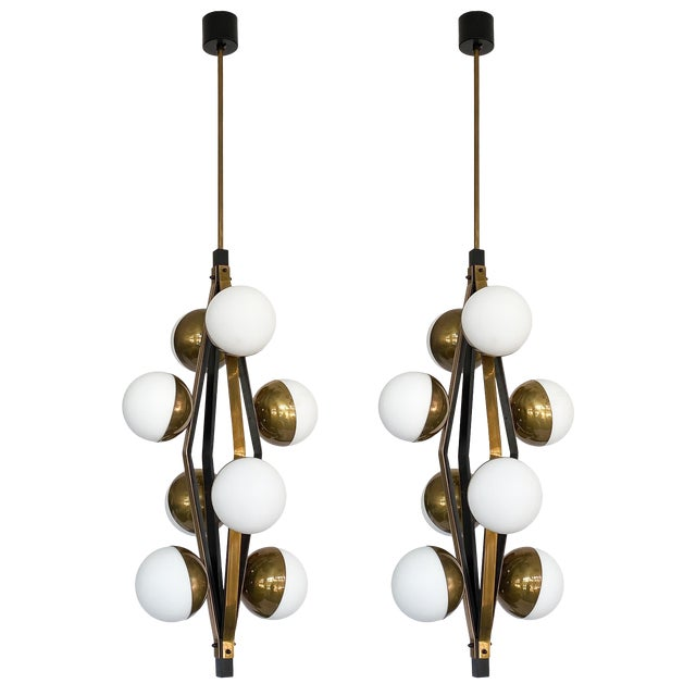 Pair of Stilnovo Brass Eight Globe Pendant Chandeliers For Sale