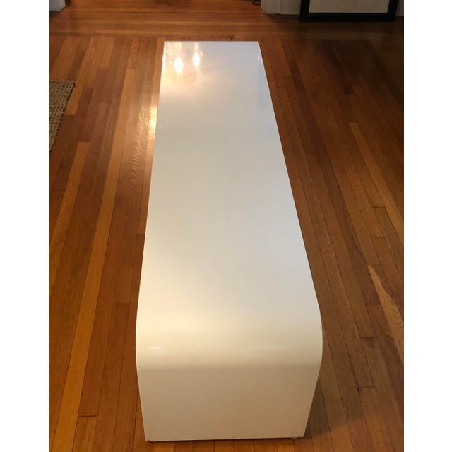 """Stunning white enameled, steel waterfall dining BENCH. Fabricated from one piece of 1/4 """" thick steel with soft curved..."""