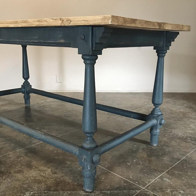 19th Century Painted Counter Table with Stripped Top features turned legs connected with stretchers, making this a great...