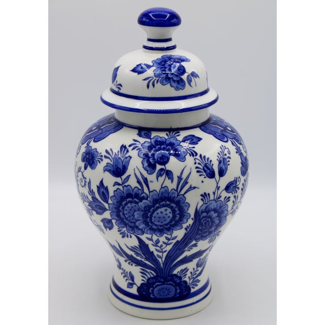A stunning royal blue and white Delft garniture set depicting a lovely floral pattern; from Holland, circa 1960....