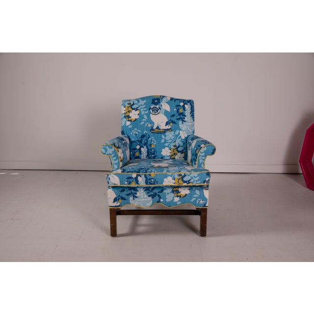 "Vintage armchair newly upholstered in the Madcap Cottage ""Manor Born"" fabric emblazoned with pugs and chinoiserie..."