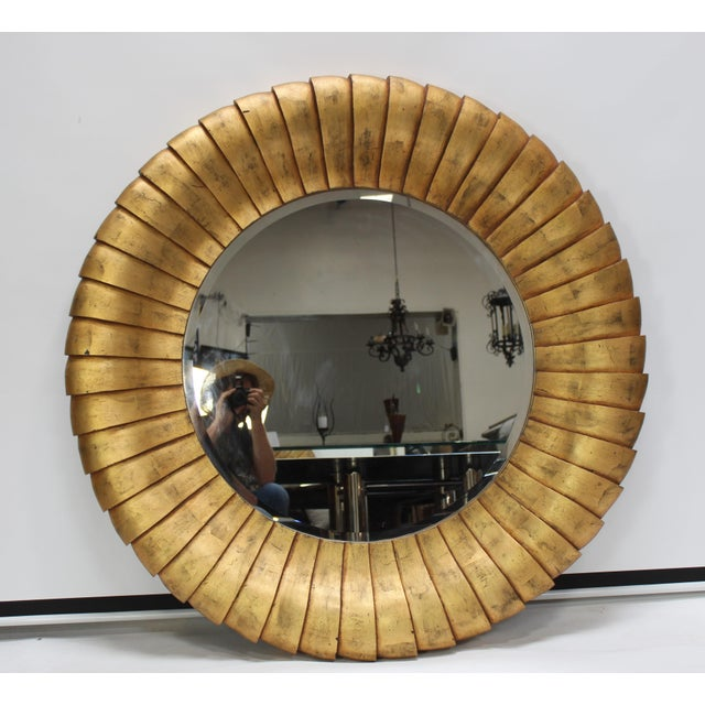 Very large contemporary round gold mirror in brushed gold leaf. Mid-century style Material: fiberglass composite....