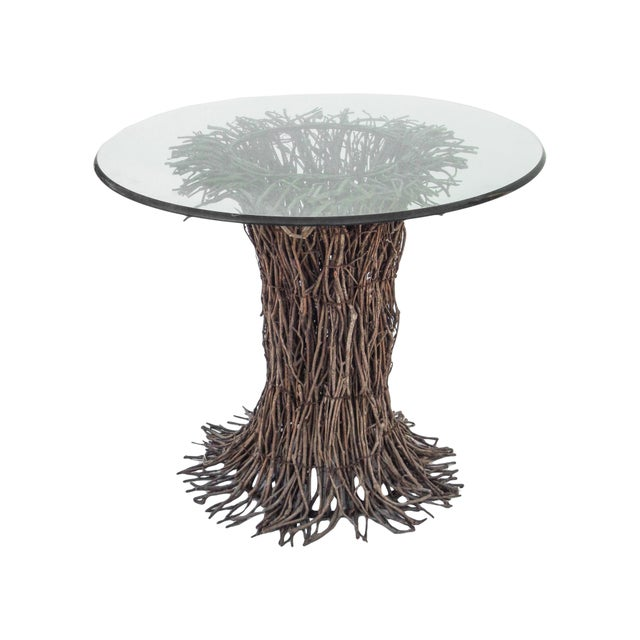Willow twig table base with glass top.