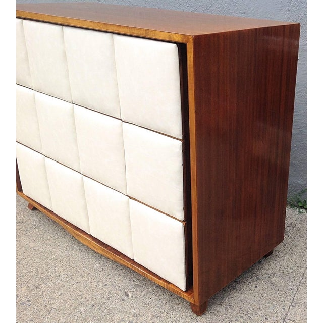 This padded front chest designed by Gilbert Rohde was introduced into the Herman Miller catalog in the fall of 1940....