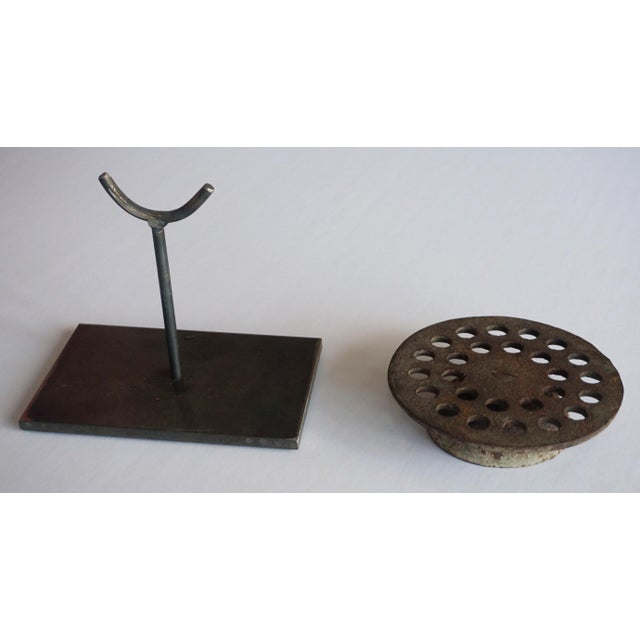 Sculpture from a Found Object put on a metal stand. Found objects can be part of a machine, or could be found by the side...