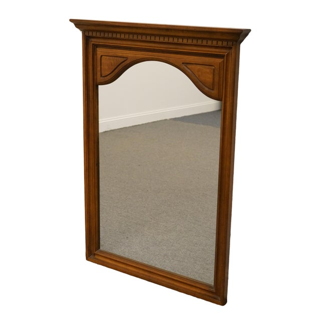 This is an Italian inspired wall mirror by Sumter Cabinet. The piece was made in the late 20th century.