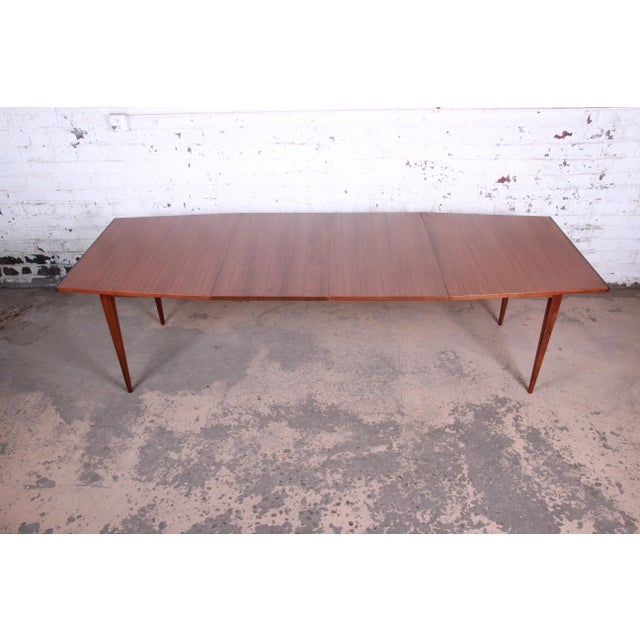 A rare and exceptional mid-century modern boat-shaped extension dining table designed by Kipp Stewart for his American...