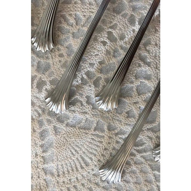 Enchanting set of Wallace 'Tiara' with shiny silver fluting down each side of the handle. An elegant addition to any...
