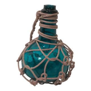 Vintage Rope Encased Blue Hand Blown Bottle For Sale