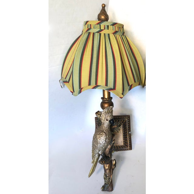 Fabulous pair of parrot sconces with yellow striped scalloped shades. Parrots have a metallic finish and are mounted on...