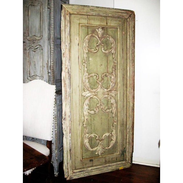 18th Century French carved and painted panel door. Was probably part of a boiserie. Pale green background with cream...