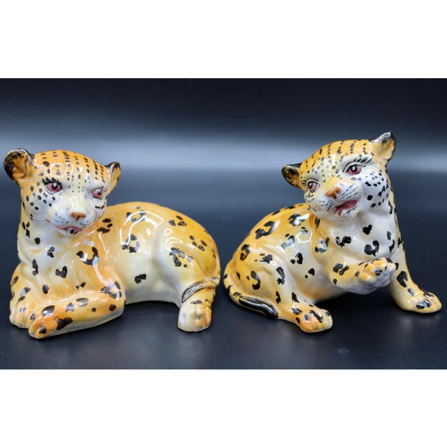 A stunning pair of Mid-20th Century Italian Mottahedeh Terra Cotta Leopards. These would look superb on a bookshelf or as...