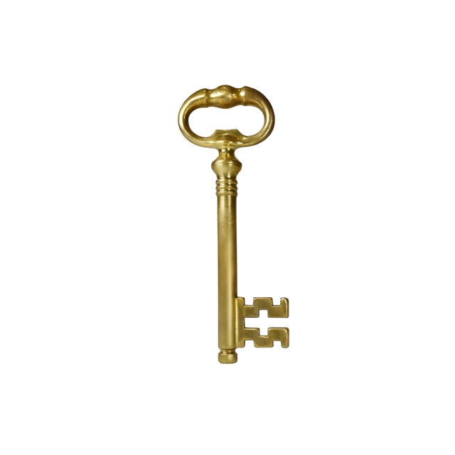 Item Details: This is a large brass skeleton key with a hidden corkscrew. Pull apart the key to reveal the hidden...