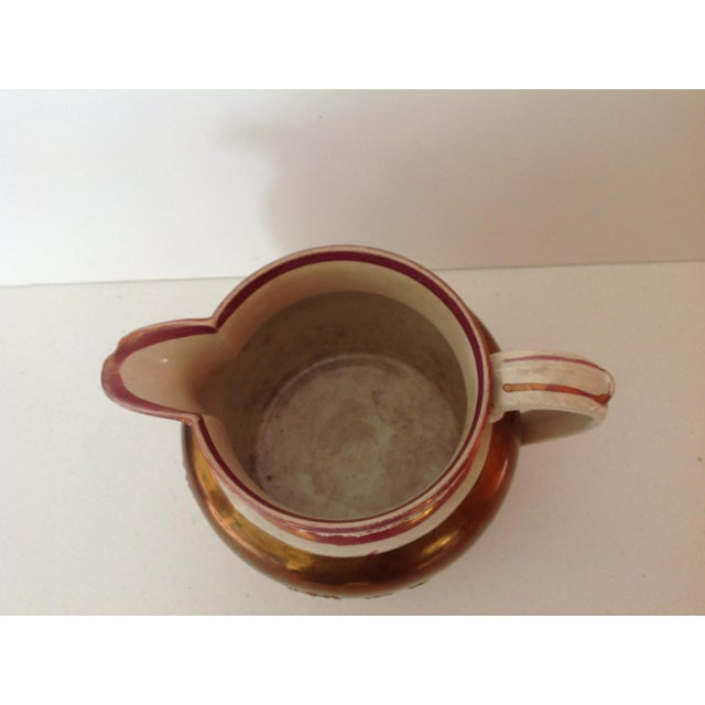 Everyone loves pitchers and if you collect antique staffordshire or lustre this is a charming addition. Complete with an...