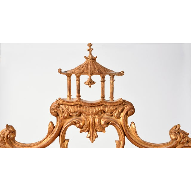 Early 20th century carved giltwood Chinese Chippendale style hanging beveled wall mirror with pagoda top crest. This...