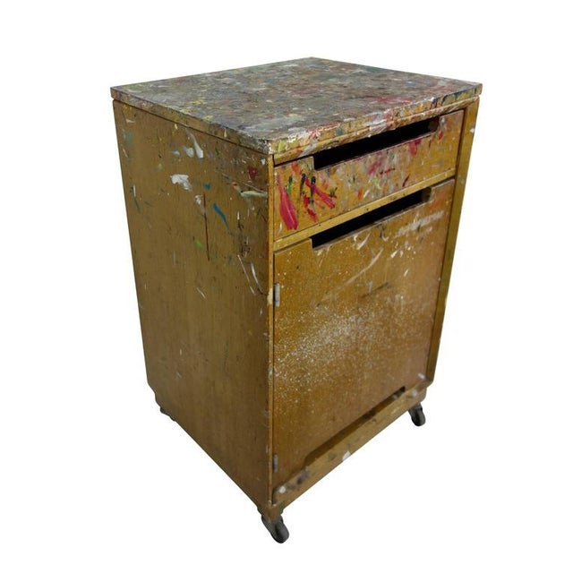 This is a neat paint splattered cabinet on casters from an artist's studio.