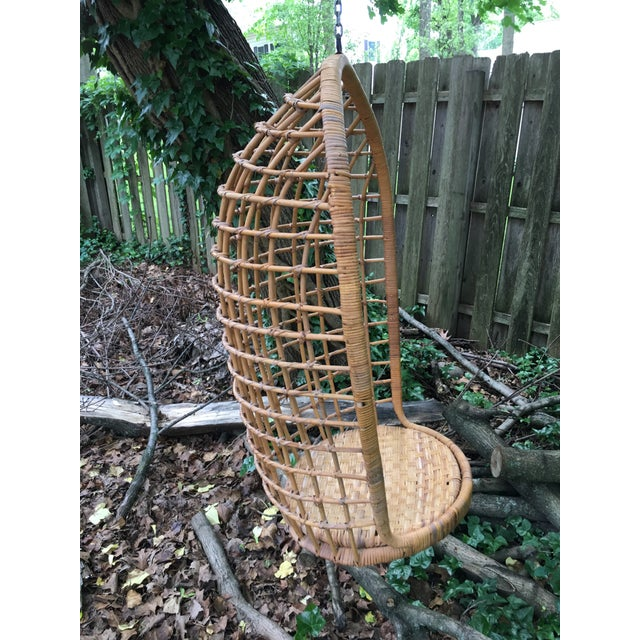 Vintage hanging egg shaped rattan chair. Perfect way to add some 1970's bohemian charm to your space. Very sturdy and...