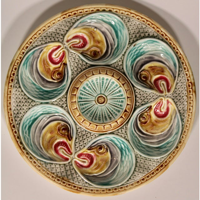 Rare 19th Majolica fish heads oyster plate from North of France, by Onnaing. The colors are superb with a light blue...