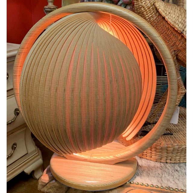 Very special Scandinavian Modern accent lamp. The nautilus shell-like shade is made of thin strips of decorative,...