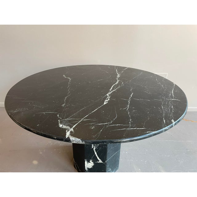 Perfect table for 2, 4, or an entry way. Black and white/ivory marble. Excellent vintage condition.