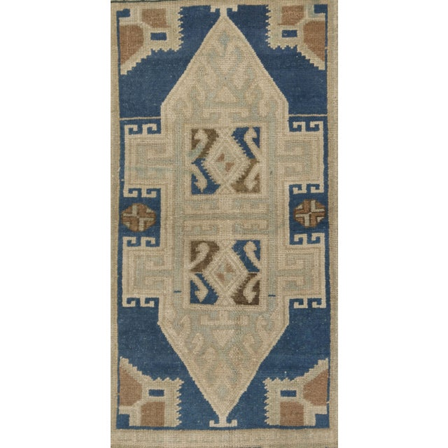 Vintage Turkish rug in warm color palette, handwoven of high-quality wool. Colors beige/blue/green/taupe.
