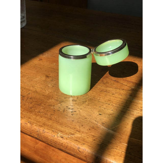 Beautiful green opaline glass box with polished brass trim.