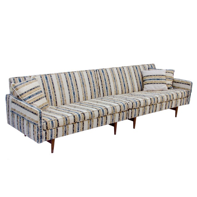 Mid-century modern two piece sectional sofa with elegant damask upholstery. Three pillows and arm covers. Excellent...